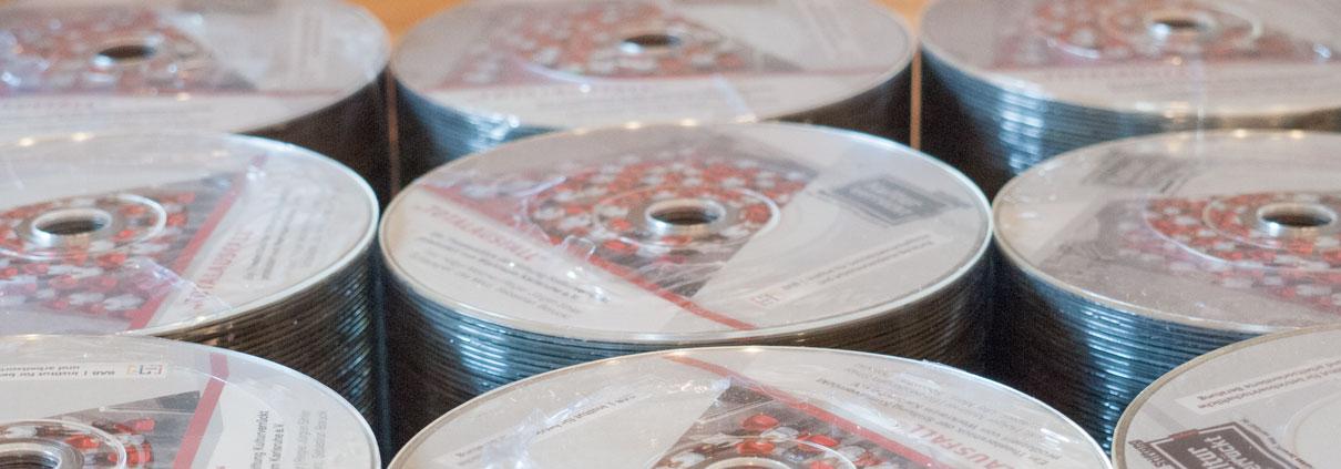 Bedruckte CD und DVD Rohlinge im Sieb-, Offset-, Thermo-RE-Transfer- oder UV-Digitaldruck